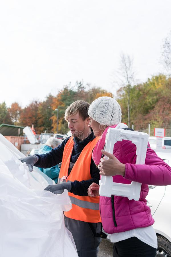 Woman and man on recycling center with Styrofoam stock photos