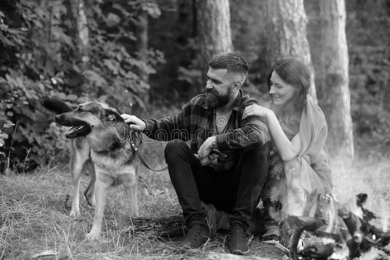 Woman and man on vacation, enjoy nature. Couple in love, young happy family spend leisure with dog. royalty free stock photos