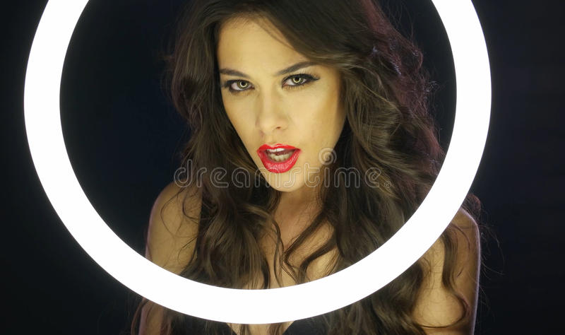Woman with Messy Makeup Behind Circle Fluorescent royalty free stock photos