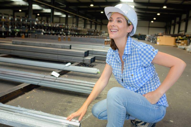 Woman in metalworking factory. Metalworking royalty free stock photo