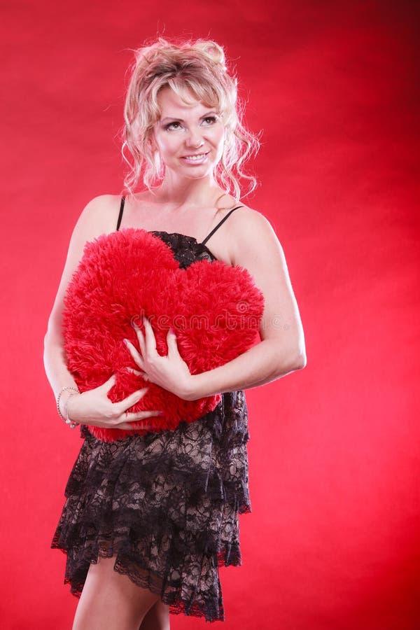 Mature woman hug big red heart royalty free stock photography
