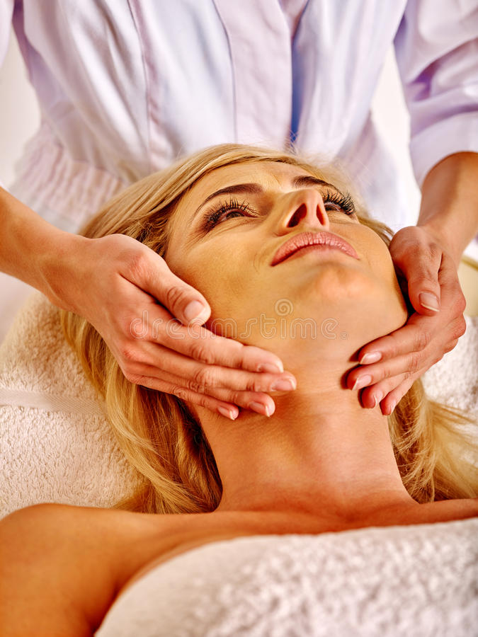 Woman middle-aged take face massage in spa salon royalty free stock photos