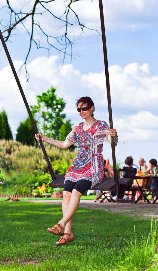 Woman of middle in park. The woman of middle age has a rest in park royalty free stock photo