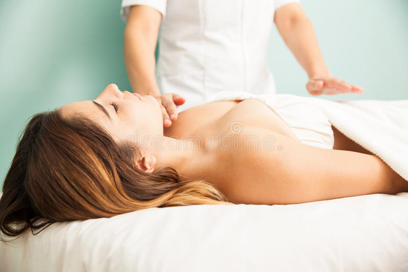 Woman in the middle of a reiki therapy session royalty free stock photography