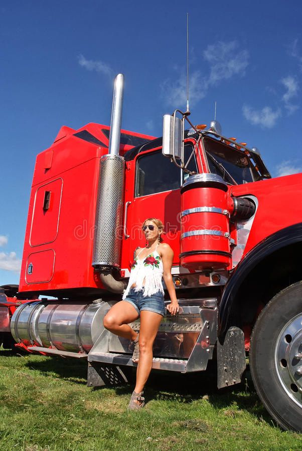 Woman and Mighty Truck royalty free stock image