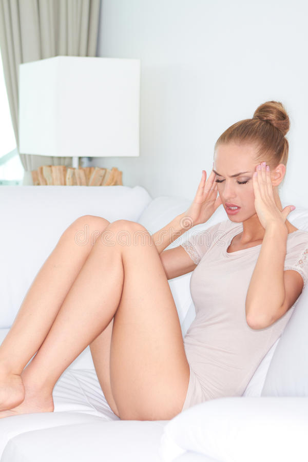 Woman with migraine headache royalty free stock image