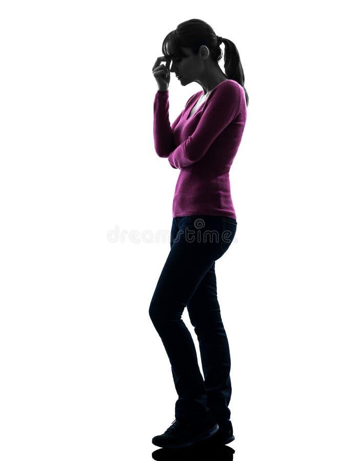 Woman migraine headache full length silhouette stock photography
