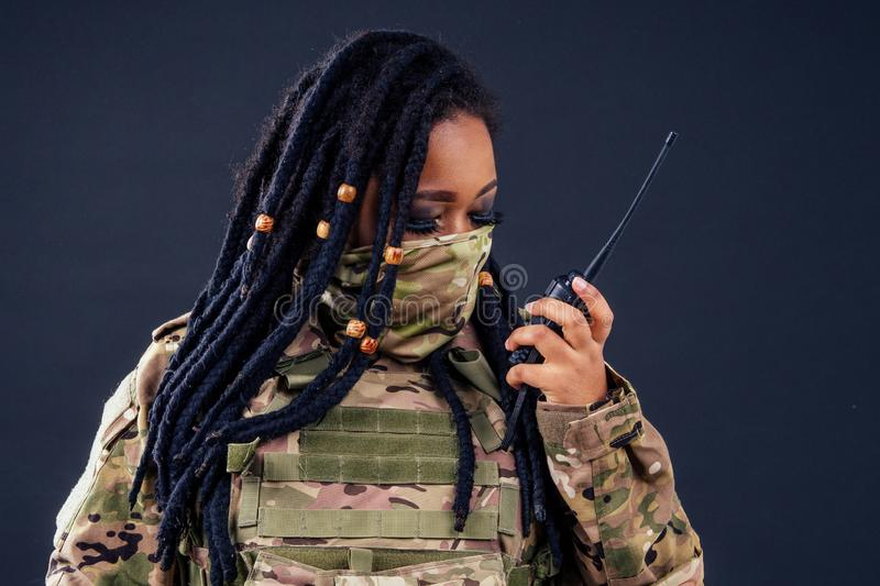 Woman in a military camouflage with a radio afro american army latin soldier in camouflage clothes hair dreadlocks royalty free stock photos