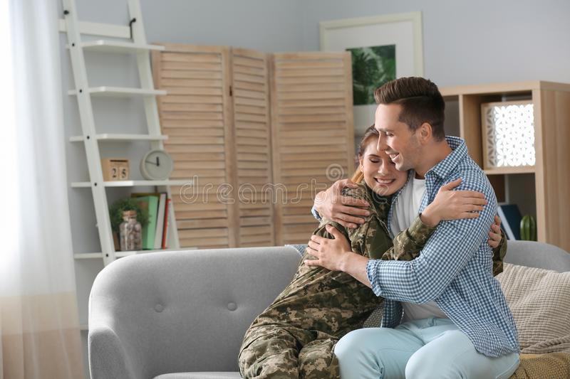 Woman in military uniform with her husband stock photos