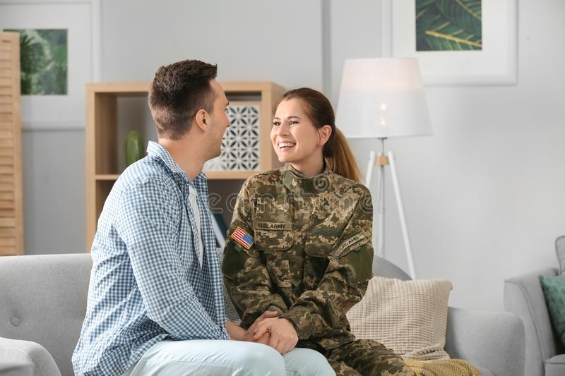 Woman in military uniform with her husband stock images