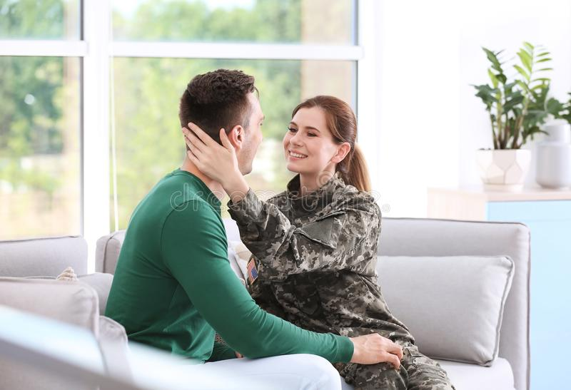 Woman in military uniform with her husband royalty free stock image