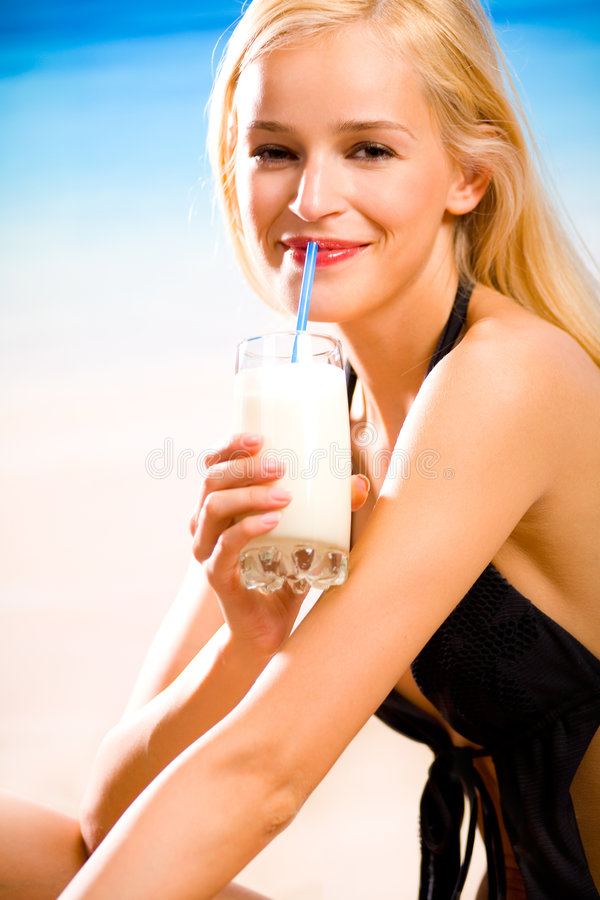 Woman with milkshake royalty free stock photos