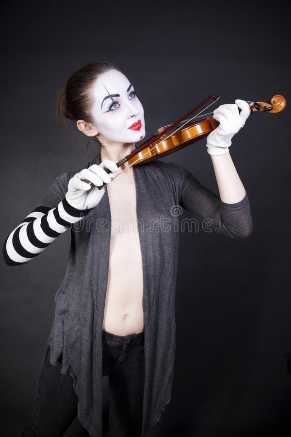 Woman mime playing the violin stock image