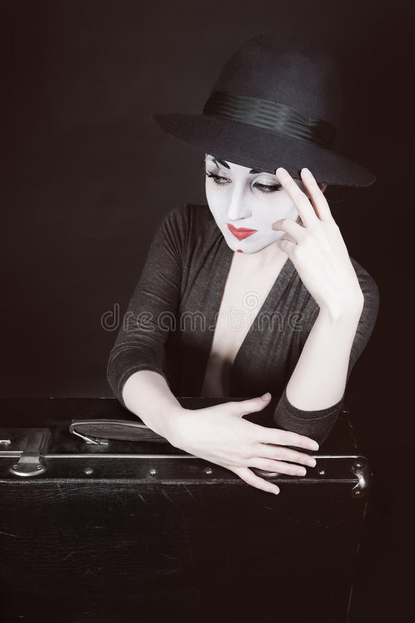The woman mime sits next to the suitcase royalty free stock photos