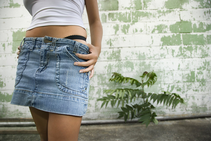 Download Woman in mini skirt. stock image. Image of female, wall - 2424555