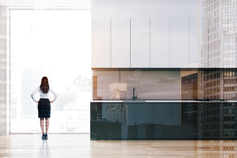 Woman in minimalist kitchen with countertops stock photos