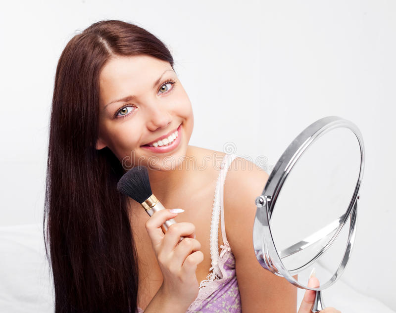 Woman With A Mirror Stock Photography