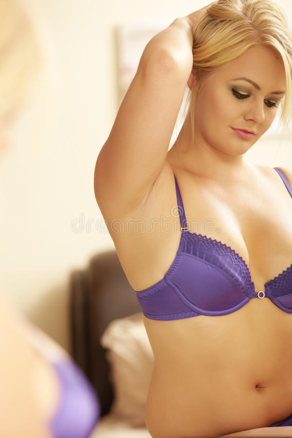 Download Woman in mirror stock photo. Image of female, purple - 25309674