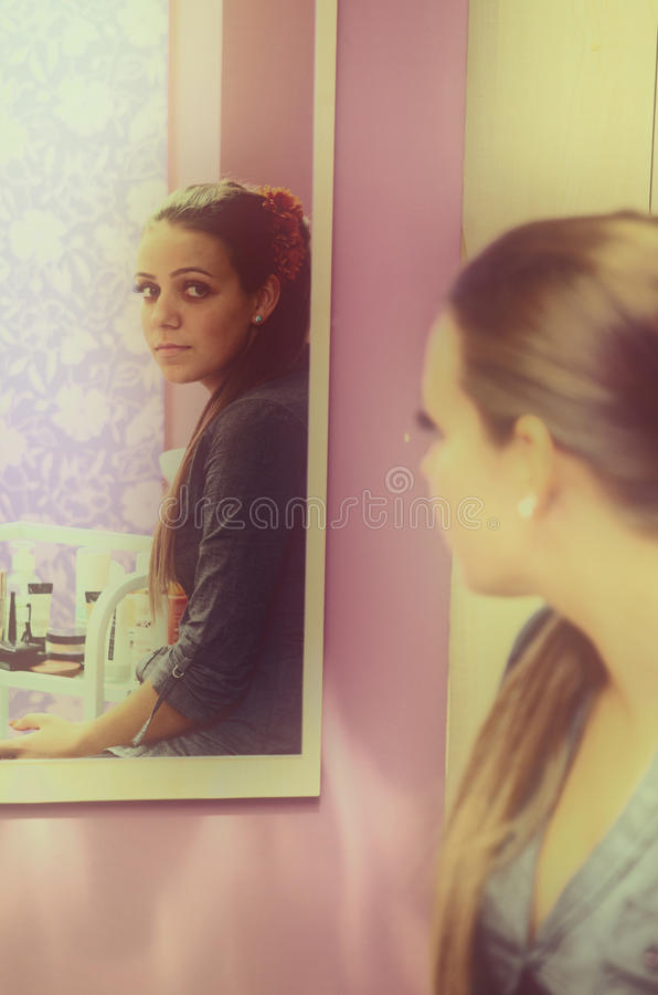 Woman in mirror royalty free stock photos