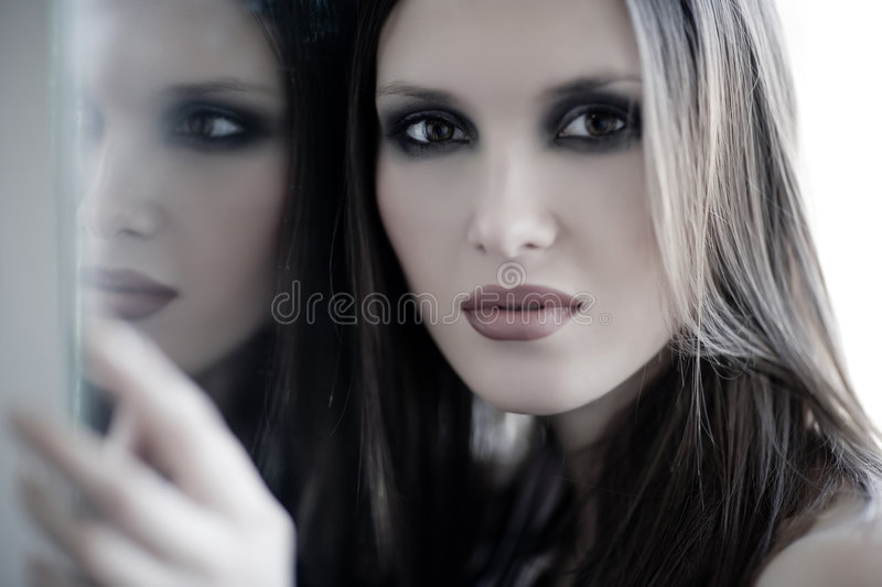 Woman and mirror stock photos