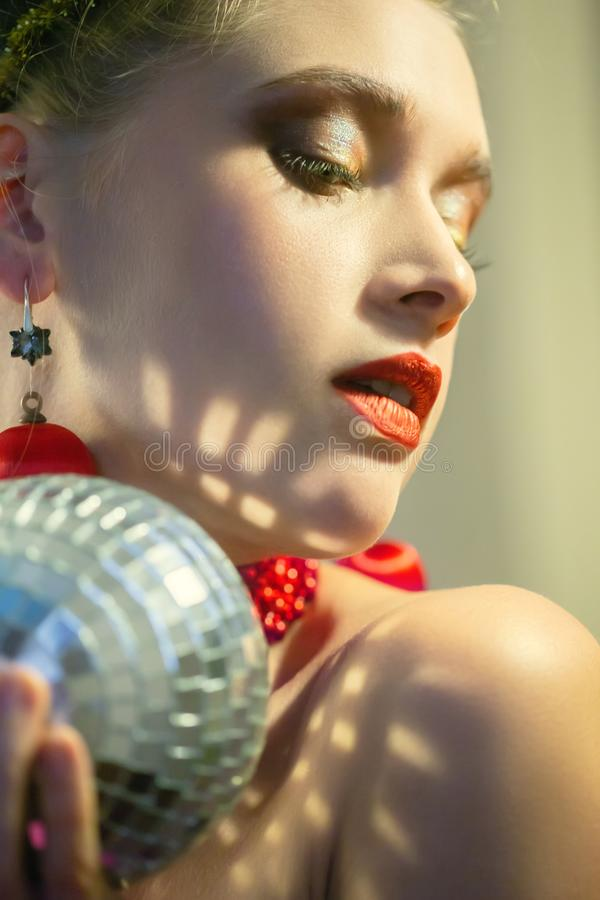 Woman with mirror ball. Sensual young woman with mirror ball closeup portrait royalty free stock photo