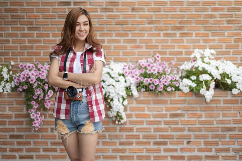Woman with mirrorless camera. On brick wall background stock photos