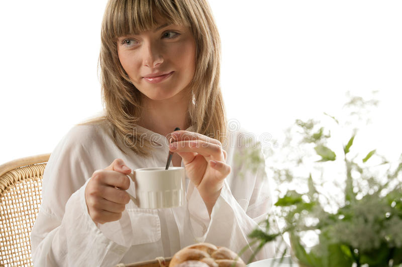 Woman mixing tea. Young beauty woman having breakfast isolated on white background stock photos