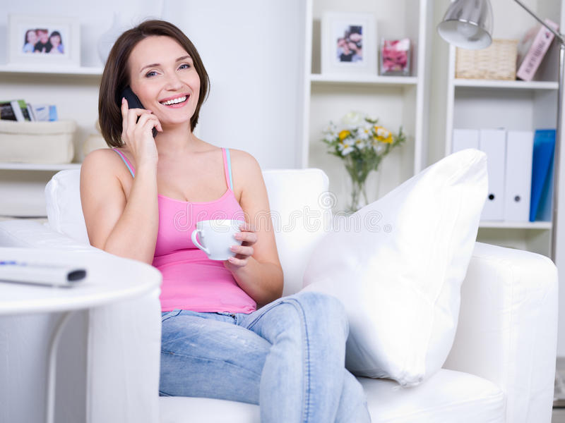 Woman With Mobile At Home Stock Photography
