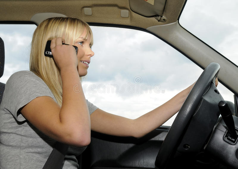 Download Woman With Mobile Phone In The Car Stock Photo - Image of risk, phone: 16278838