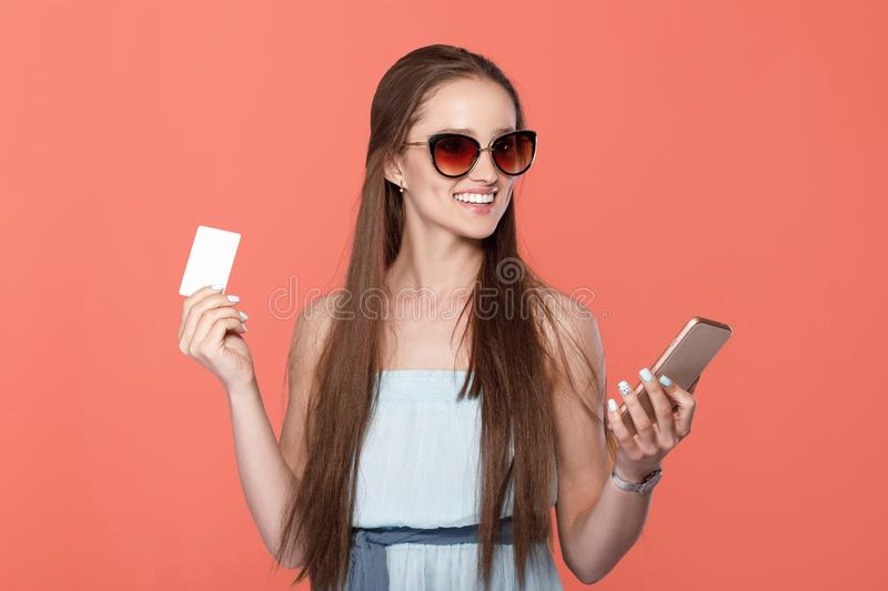 Woman with mobile phone and credit card stock images