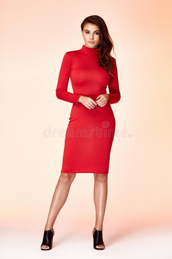 Woman model fashion style red skinny dress beautiful secretary diplomatic protocol office uniform stewardess air hostess business royalty free stock image