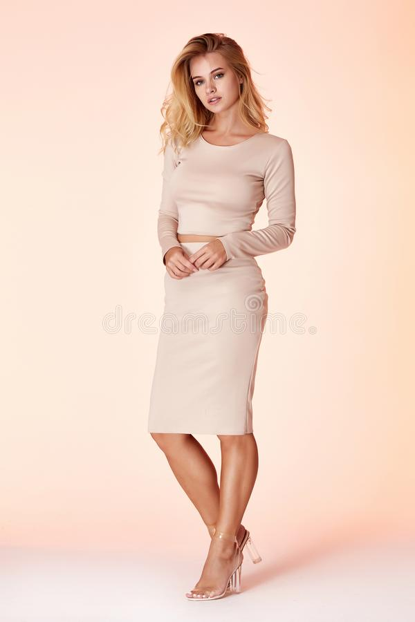 Woman model fashion style skinny dress beautiful secretary diplomatic protocol office uniform stewardess air hostess business lady. Perfect body shape blond stock images