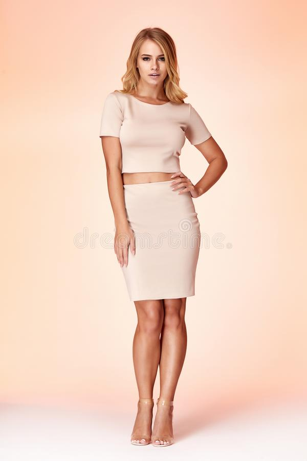 Woman model fashion style skinny dress beautiful secretary diplomatic protocol office uniform stewardess air hostess business lady. Perfect body shape blond stock image