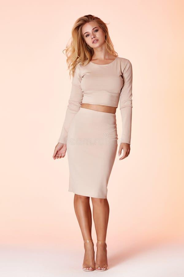 Woman model fashion style skinny dress beautiful secretary diplomatic protocol office uniform stewardess air hostess business lady. Perfect body shape blond stock photos