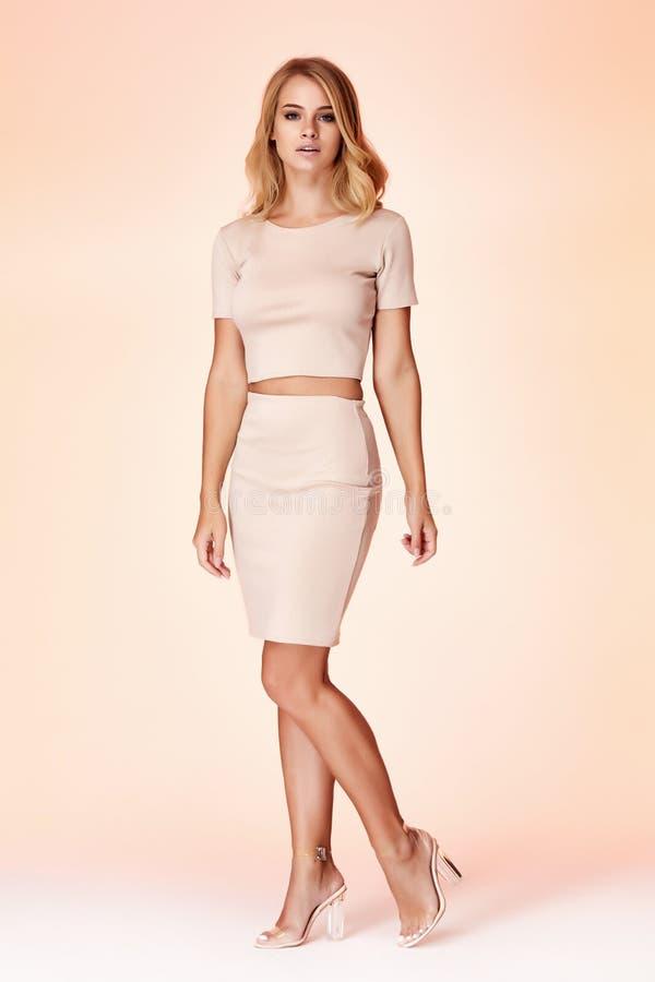 Woman model fashion style skinny dress beautiful secretary diplomatic protocol office uniform stewardess air hostess business lady. Perfect body shape blond royalty free stock image
