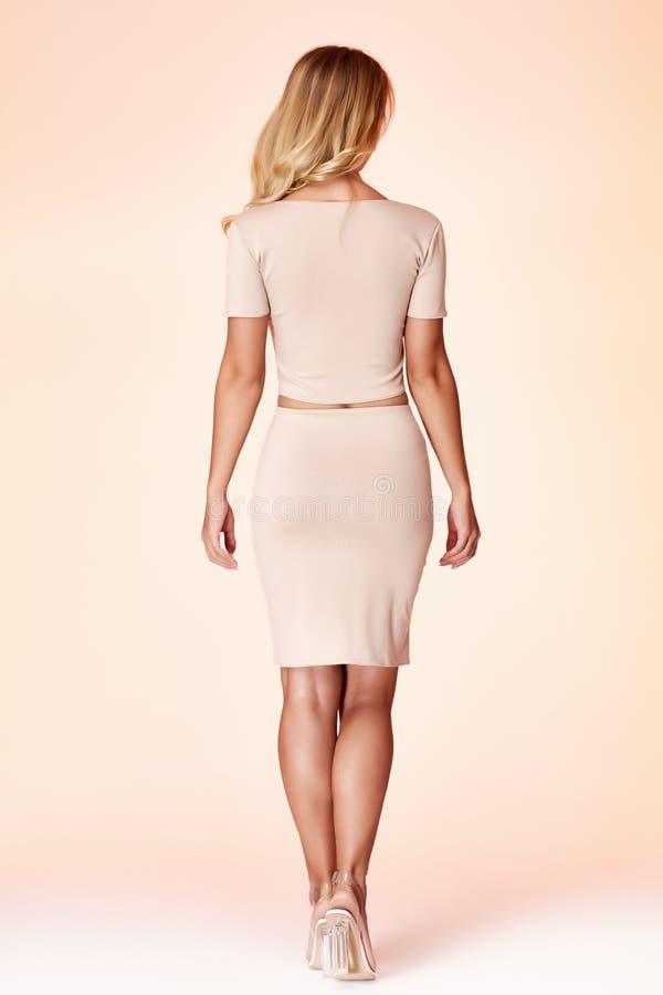 Woman model fashion style skinny dress beautiful secretary diplomatic protocol office uniform stewardess air hostess business lady. Perfect body shape blond royalty free stock photo