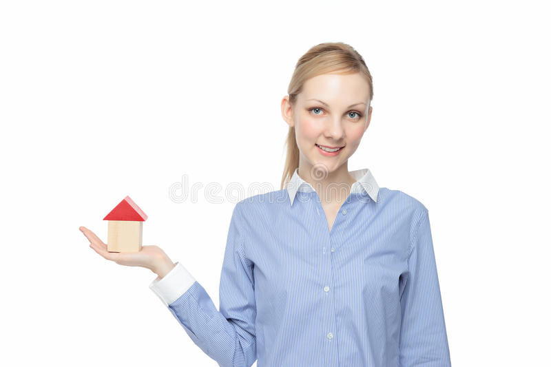 Woman with a model of a house stock images