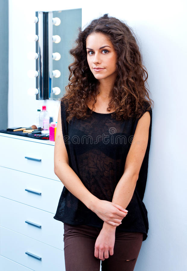 Woman model and make up table stock photography