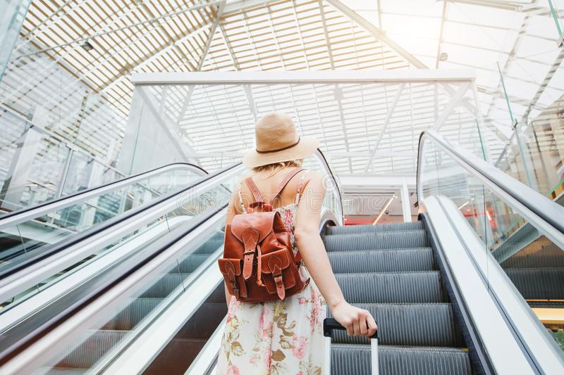 Woman in modern airport, people traveling with luggage royalty free stock photography