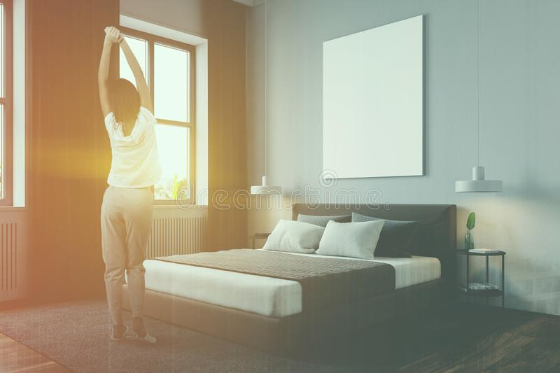 Woman in modern bedroom with poster stock photos