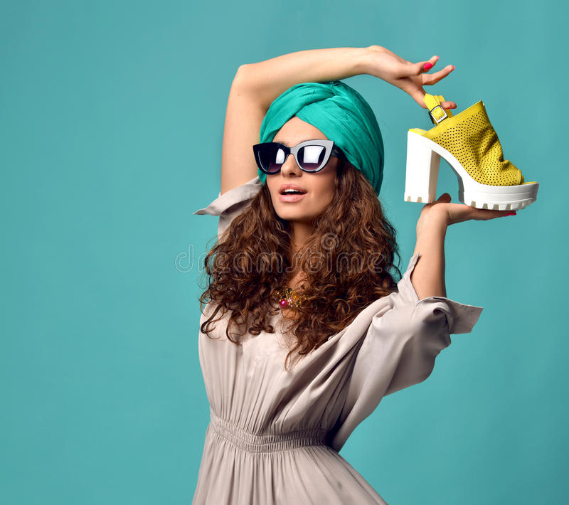 Woman in modern cat eyes sunglasses with white yellow shoe stock images