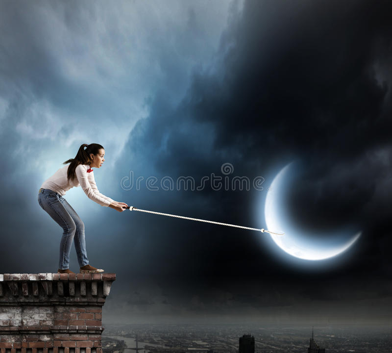 Woman with moon. Young woman in casual holding moon on lace royalty free stock photos