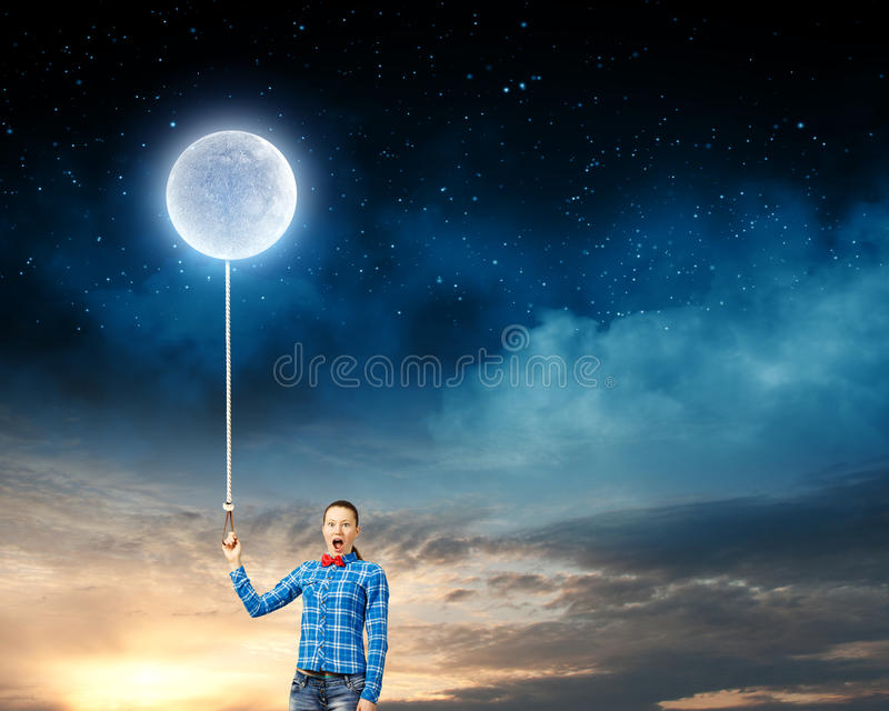 Woman with moon. Young woman in casual holding moon on lace stock image