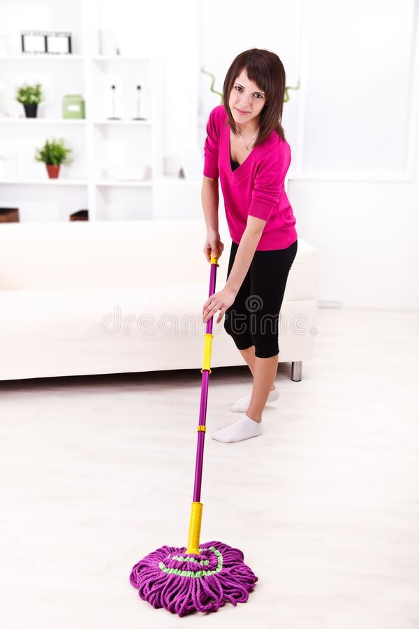 Woman with mop royalty free stock images