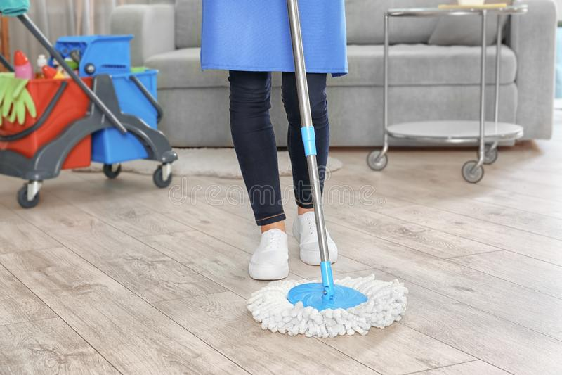 Woman mopping floor royalty free stock photo