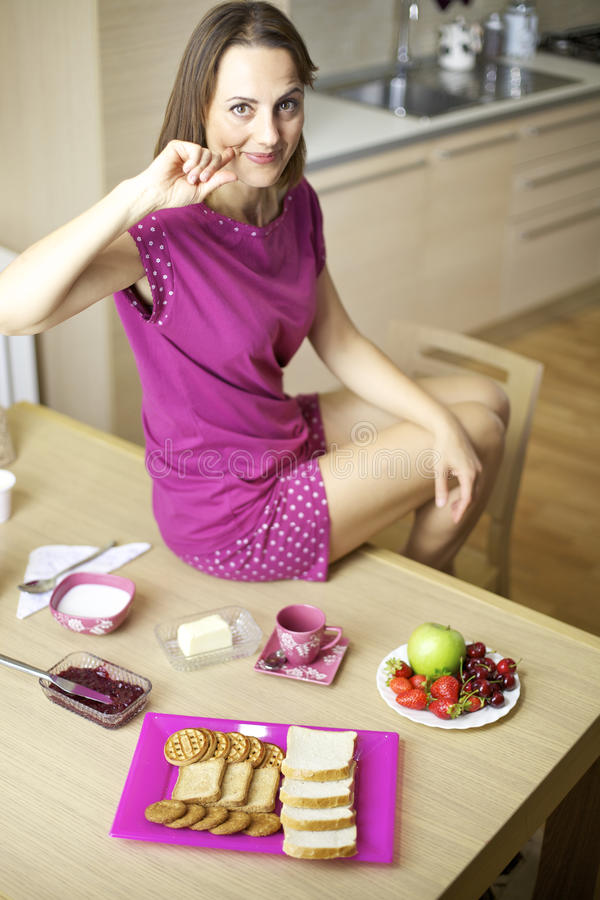 Woman in the morning happy about good continental breakfast stock image