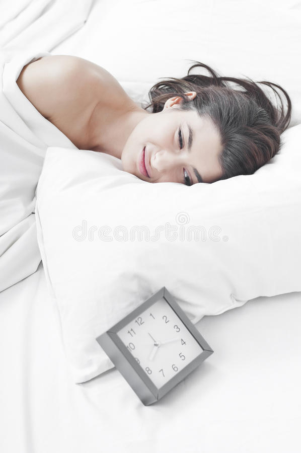 Download Woman In The Morning Looking At A Clock Stock Photo - Image: 21964192