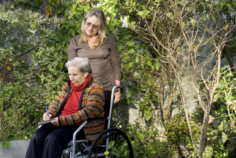 Woman with Mother in Garden - Horizontal royalty free stock photography