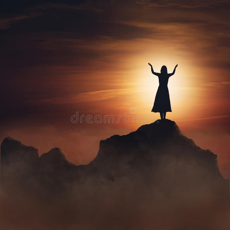 Woman on mountain. royalty free stock photography
