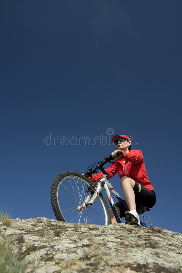 The woman on mountain bicycle stock images
